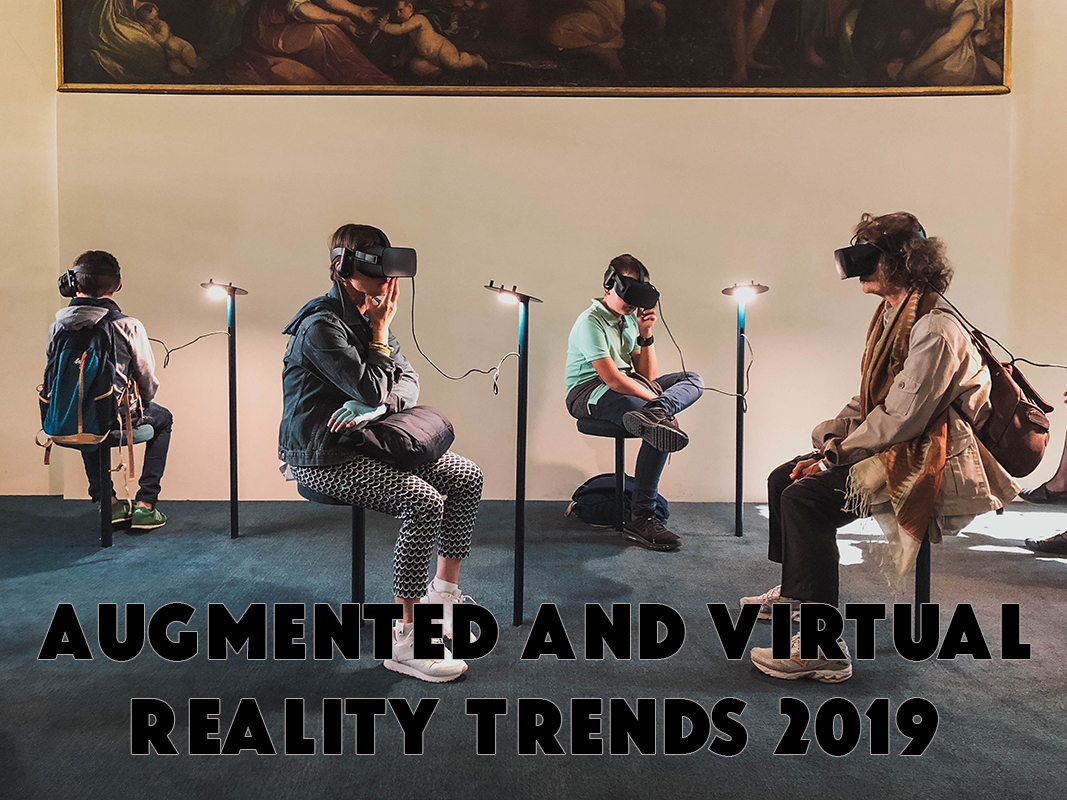 Augmented and Virtual Reality Trends in 2019. 4 people sitting on the chair and using VR.