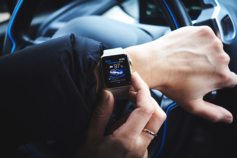 Driver with an Apple Watch.
